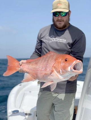 Ryman Koester with a healthy red snapper.
