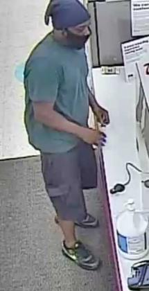 Police are searching for the man in this photo in connection with an armed robbery.